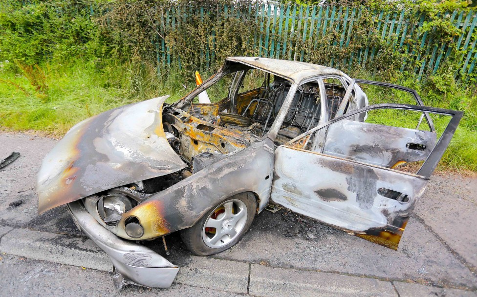"""Saturday 28th June 2014 - Belfast Northern Ireland  A stolen car pictured burnt out  in the Poleglass estate following a night of """"Joy Riding"""" on a major scale   Picture - Kevin Scott"""